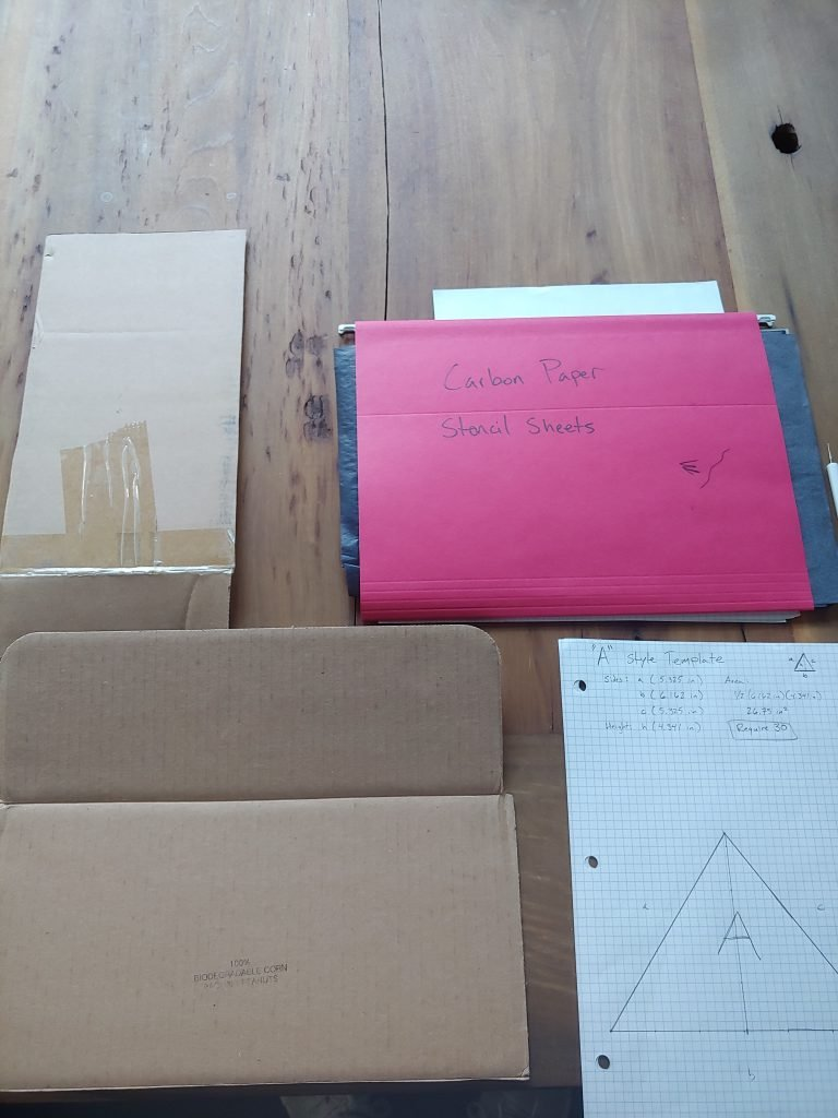 carbon transfer paper, graph paper, and cardboard for making blanks